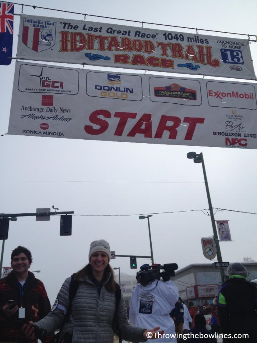 Standing under the starting arch of the 2013 Iditarod
